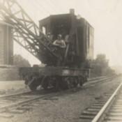 Clint E. Snook Placing Girders on Clare Creek Bridge, 1939
