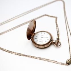 Goodrich gold pocket watch with chain